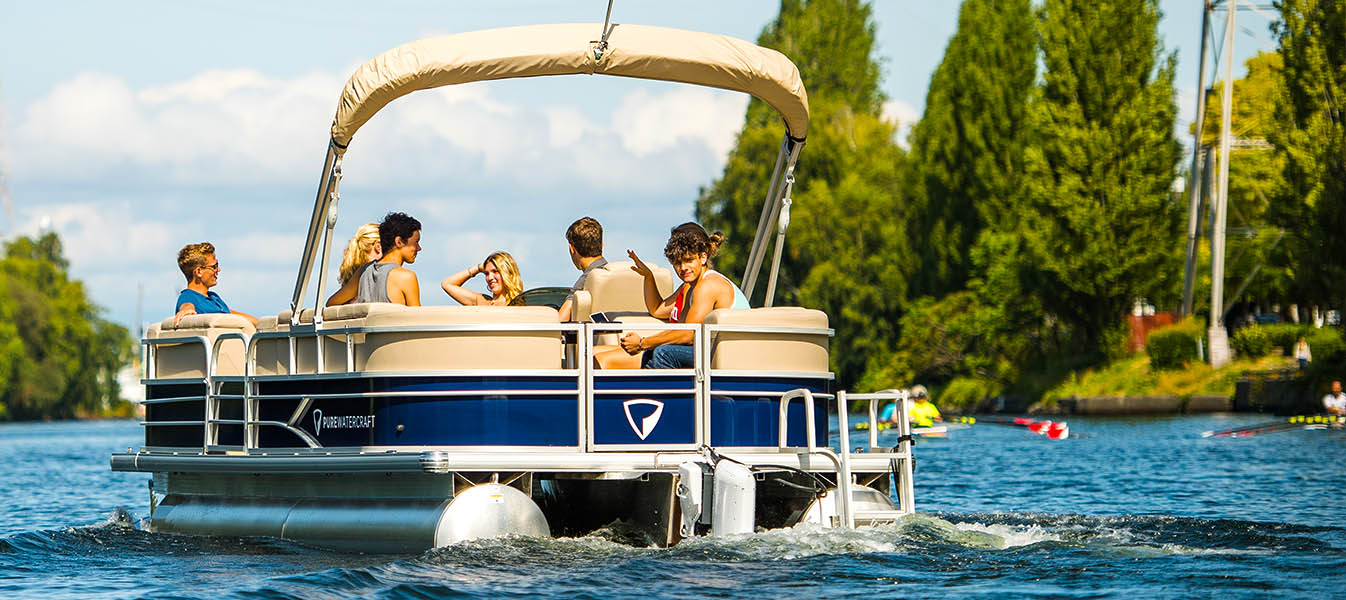 Young people on pontoon boat with electric outboard motor